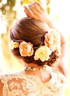 Bride's low loose bun with flower crown corona halo wedding hairstyle  ♔
