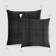 Handcrafted in Mexico by  Artisans of Toluca Valley  This pillow is a thing of beauty. The black and white color scheme highlights ancient ikat patterns, and th
