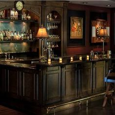 Traditional (Victorian, Colonial) Bar by Linda Allen | Dark wood, very traditional and old-fashioned looking with the underbar paneling.