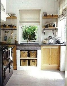 *Great kitchen: rustic and orderly. Like the central Roman blind. Chunky sink and storage baskets. Open shelves. Two -panel natural wood kitchen cabinets.