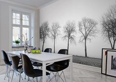 modern scandinavian dining room with parquet floor, white dining table, black dining chairs and accent wall with black and white photo wallpaper trees Source by ralfspelsberg Black Dining Chairs, White Dining Table, Dining Room Walls, Dining Room Design, Room Feng Shui, Mid Century Modern Dining Room, Zara Home, Bright Rooms, Mid-century Modern