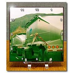 A truck done in a green finish going down the highway Desk Clock