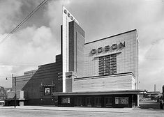 As these photographs show, the once-majestic art deco Odeon cinemas have become uninspiring shopping blocks, bingo halls and stationary superstores. Unique Buildings, Interesting Buildings, Cinema Architecture, Bauhaus Architecture, Amsterdam, Streamline Moderne, Tower Design, Brick And Mortar, Arquitetura