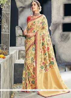 This is a gorgeous Banarasi Silk saree comes with Contrast Raw Silk blouse. This pretty saree features all over multi floral design on Banarasi Silk fabric with lace work border to complete the attire look. This sari is a must have in your wardrobe. Designer Silk Sarees, Designer Sarees Online, Art Silk Sarees, Sabyasachi, Lehenga Choli, Anarkali, Sari, Net Saree, Saree Dress
