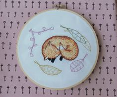Forty Winks Fox is a wonderful hand embroidery pattern featuring a snoozy fox in foliage. A versatile pattern which will look good as wall art or on a cushion. Or even as unique addition to a bag or a piece of clothing!Finished size is about 4.5 by 5.5 inches.This 10 page PDF pattern contains:- the original pattern and a reversed version of the pattern for easy transferring.- details on colours, strands and stitches used in the example embroidery- details on how to pick ...