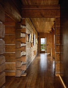Hand-hewn, square-cut Douglas fir logs reference the modern home's log cabin inspiration.