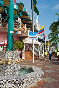 Main street shops in Oranjestad, Aruba, Caribbean. I want to retire here. Best of both worlds, beach and Europe.