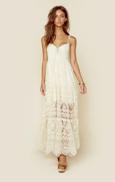 """This dreamy maxi dress features a sheer lace fabrication throughout, lace up front detailing, and a scalloped hem. Partially lined. Made in MexicoDry Clean Only100% CottonFit Guide:Model is 5ft 9 inches; Bust: 32"""", Waist: 24"""", Hips: 34""""Model is wearing a size XSRelaxed FitShoes Featured Not Available For Purchase"""