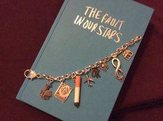 The Fault in Our Stars Charm Bracelet by WitzendDesigns on Etsy, $20.00. No. Freaking. Words.