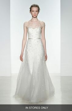 Free shipping and returns on Christos Bridal 'Ellie' Embellished Illusion Neck Tulle Gown (In Stores Only) at Nordstrom.com. This wedding gown can't be purchased online but is available for special order in our in-store Wedding Suites. Special orders ship within 8–16 weeks. Please call 1.888.300.1295 to find a Wedding Suite near you or Book an appointment online.Delicate floral appliqués drift down an enchantingly sweet tulle gown styled with sheer illusion veiling the sweetheart bodice and…