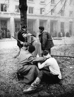 A member of the Hungarian secret police has been captured by the enraged crowd during the revolt of the Hungarian people against the Soviet tyranny. Budapest, November 1956 Get premium, high resolution news photos at Getty Images Old Pictures, Old Photos, Budapest, Great Sword, World Conflicts, Mario, Historical Photos, Photo Art, The Unit