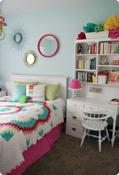 Adorable girls room. I could spray paint mirrors from goodwill in awesome colors!