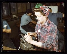 One of the girls of Vilter [Manufacturing] Co. filing small gun parts, Milwaukee, Wisc. One brother in Coast Guard, one going to Army.  (LOC) | by The Library of Congress