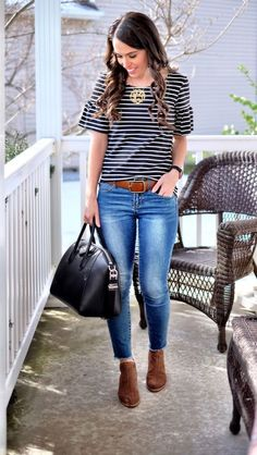 Striped Ruffle Sleeve Tee black and white outfit idea, black givenchy antigona, brown statement belt, perforated ankle booties