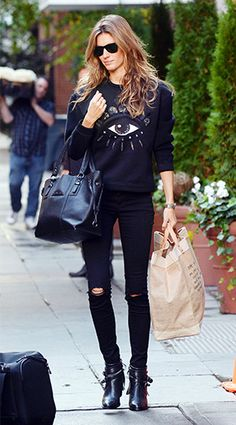 Gisele Bundchen wearing all black. We love her Kenzo sweater. (Click for the rest of the details on her outfit.)