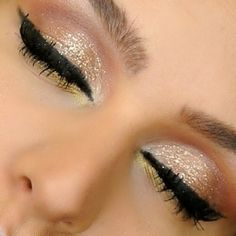 Use gold glitter with bold black liner for a clean, dramatic eye!