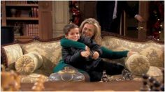 Sami hugging her son Johnny, as his father EJ comes into the room.