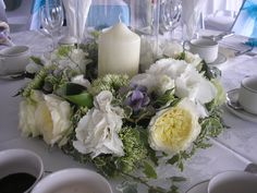 Garden Roses, Hydrangea and Trachelium. Hurricane Vase with ring of flowers around, with central candle.