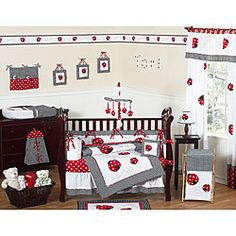 This ladybug-themed 9-piece baby bedding set was created by JoJo Designs. This set includes a blanket, crib bumper, crib skirt, fitted sheet, toy bag, decorative throw pillow, diaper stacker, and two window valances.