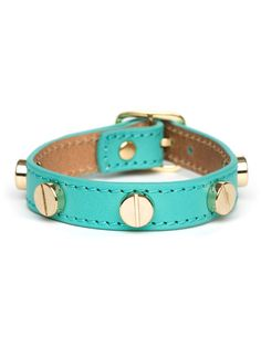 This item is the Newbie Knockout Winner! Selected as the Fan Favorite on Facebook, this item will be available at an insider-only price through 7/11  Downtown chic gets a stylish serving of girlish charm in this adorable wrap bracelet. Crafted from luxe leather, it's cast in adorable aqua or bubblegum pink, right down to the stitching, and flaunts a glam set of bolt-like studs.