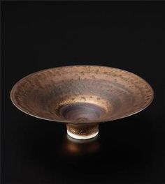 Small footed bowl, Porcelain, bright golden manganese, terracotta and black glaze. 5 5/8 in. (14.3 cm.) diameter, c.1976