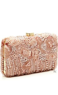 How gorgeous is this blush pink ruffled clutch? We must have one ...