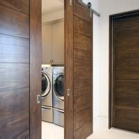 Pair Of TM9000 Sliding Barn Doors In Walnut With Asymmetric Stiles And Kerf Cut Reveal