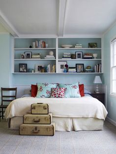 bookshelves in place of a headboard? yes. no more getting up to read at night!