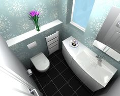 WC - cloakroom design - This compact installation included a toilet and wash-basin.    The client requested as much storage space within the cloakroom as possible. By utilising this offset vanity unit, additional storage space was created without encroaching on to the WC area.