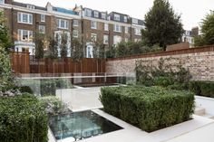 The garden was designed by a gold medallist at Chelsea Flower Show and has water features. Holland House, London Townhouse, Mirror House, English House, House On A Hill, Home Photo, Image House, Exterior Design, Property For Sale