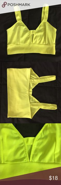 Sexy Neon Yellow Crop Top Neon yellow/green crop top with small slit. Fits like a sports bra in regards to length. From Tobi. Barely worn. Fun top :) Tobi Tops Crop Tops