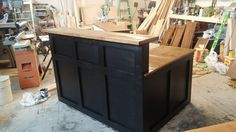 Reception desk done in a farm house style yet contemporary.  Black squares with a walnut stain on pine desk top.