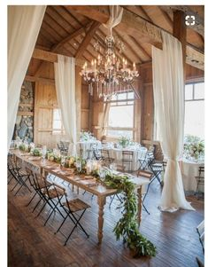 For those who prefer to have their favorite rustic wedding outside, a barn wedding could be the perfect solution. Barn wedding theme is becoming more and more popular as it not only saves so much c… Rustic Wedding Reception, Wedding Reception Centerpieces, Reception Ideas, Wedding Barns, Indoor Wedding Venues, Rustic Barn Weddings, Tulle Wedding Decorations, Wedding Ceremony, Wedding Draping