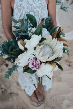Amazing Wedding Bouquet Which Includes: King Protea, Peonies, Magnolia Foliage, Other Florals & Foliage