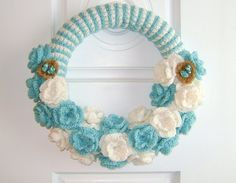 http://itsbetterhandmade.com/handmade-14-inch-crochet-turquoise-and-white-wreath-with-bird-nest/