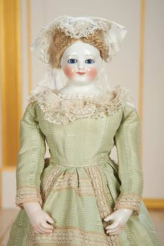 View Catalog Item - Theriault's Antique Doll Auctions . Very Beautiful French Porcelain Glass-Eyed Lady Doll Attributed to Leontine Rohmer