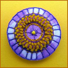Embroidered button/brooch | Stitched with wool, Perle 8 and … | Flickr