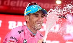 Vincenzo Nibali celebrates in the maglia rosa of the overall leader of the Giro d'Italia.