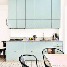Aerugo Green Superfront-kitchen with mixed fronts; Plain & Harlequin-pattern. Holy Wafer handles in brass and Plinth in brass. Built on the Ikea Metod kitchen system.