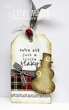 Flaky Snowman Tag...with plaid ribbon trim.