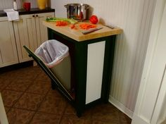 Fold out trash can container underneath a cutting board cabinet! so convenient! @Lisa Allison