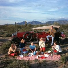 Title:Barrett Family Picnic Caption:The Barrett family enjoy a picnic in the unlikely setting of the Arizona desert, January Artist:Slim Aarons Slim Aarons, Jet Set, Les Kennedy, Cecil Beaton, Moving To California, Family Picnic, Attractive People, Family Photographer, Life Is Good