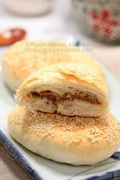 Shaobing with meat filling 鲜肉蟹壳黄  by MaomaoMom Shaobing (shāo bǐng), is a type of baked, layered flatbread in Chinese cuisine. Shaobing can be made with or without stuffing, and with or without sesame on top. Shaobing contains a variety of stuffings that can be grouped into two main flavors: savory or sweet. I made these with meat filling, very delicious.