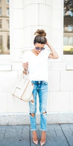 Go for a cute yet simple outfit in these ripped jeans and white tee paired with your favourite heels. Via Christine Andrew   Shops: Not Specified