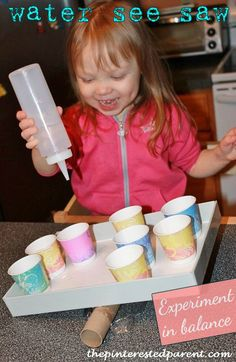 Science/math experiment with water - water see-saw experiments in balance. MS ELS for 3- and 4-year-olds OA 1; ECERS-R 26