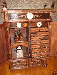 Since I dont smoke anymore, i could easily turn this Antique Style Pipe Rack Cigar Humidor Cabinet 500C into my new Vape lab.