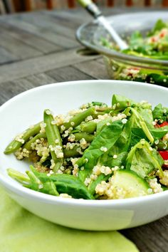 A refreshing and light quinoa salad served over spinach with a fresh lemon dressing. This simple dish is the perfect lunch, meatless entree, or compliment to grilled meat.