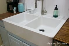 Can you believe this retro-style farmhouse sink is from IKEA and costs just a tad over $300? See the Before & After installation at www.evevrydayhomeblog.com