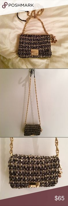 J. Crew Mini Tweed Crossbody Purse Chic black, grey, white and gold Tweed mini bag with a long gold chain crossbody strap and pearl purse charm. Very Chanel on a budget. Used 3 times. Despite the small size it comfortably holds a wallet, phone, Altoids, and keys. Approximately 8X6X3 J. Crew Bags Crossbody Bags