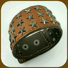 """BROWN GENUINE LEATHER METAL STAR BRACELET Two snap closures  Three rows of stars  Metal star buttons  1 1/2 """" wide 9 3/8"""" Length  If you  love rustic and leather, You will love this❤✌ BOTIQUE  Jewelry Bracelets"""